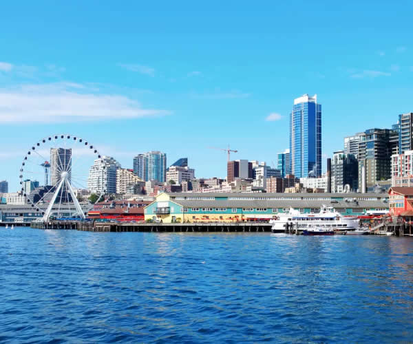 Photo of Seattle waterfront with cityscape in background.