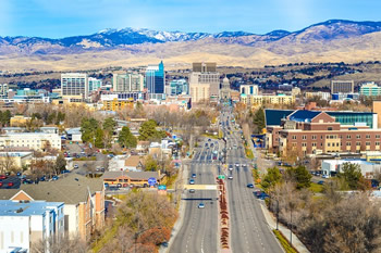 EB-5 Regional Center in Idaho. Photo of downtown Boise, Idaho with mountains in the background.