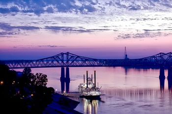 EB-5 Regional Center in Mississippi. Photo of fishing boat trawling on the Natchez River.
