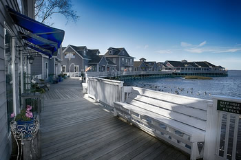 EB-5 Regional Center in North Carolina. Photo of homes on a stretch of boardwalk along the water, Outer Banks, North Carolina.