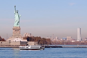 EB-5 Regional Center in New York. Photo of Statue of Liberty with New York City in the background.